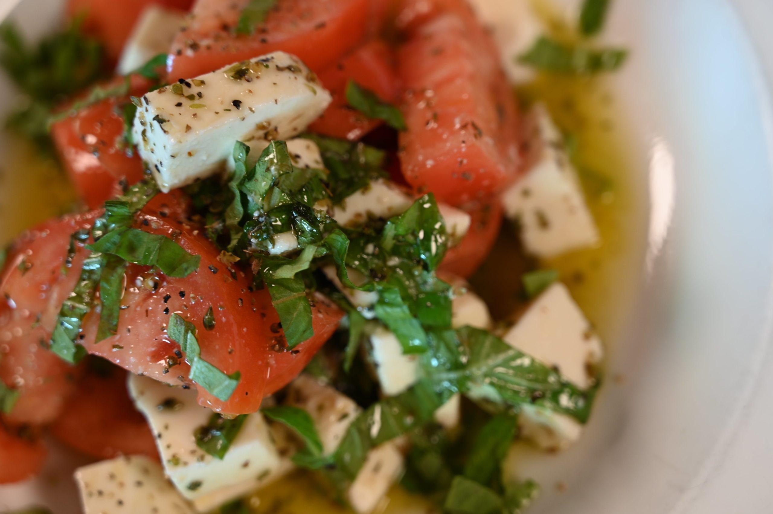 tomato salad, mozzarella cheese, oil dressing