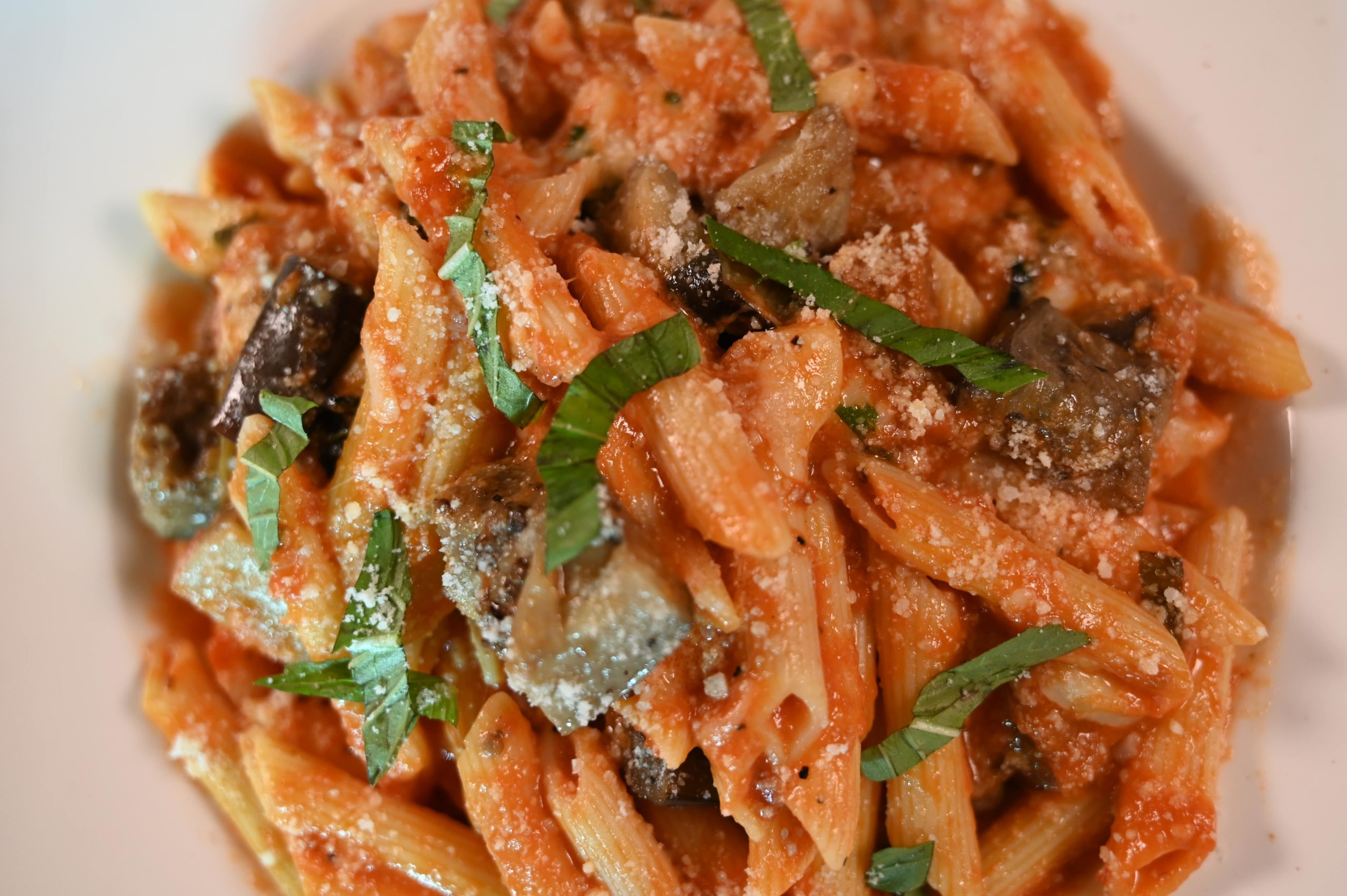 Taormina, sweet sausage, plum tomatoes, garlic, extra virgin olive oil, spinach, parmigiana cheese, penne pasta